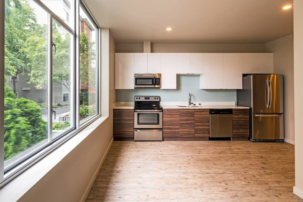 Custom wood cabinetry and stainless-steel appliances in a model home at Verse Seattle in Seattle, Washington
