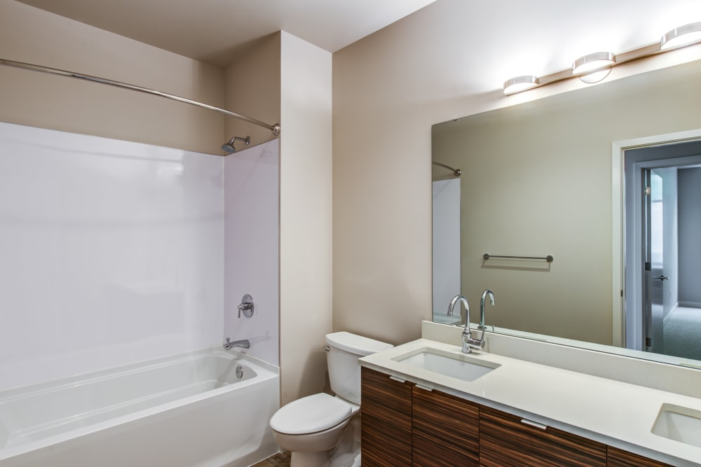 Custom wood cabinetry in a model home's bathroom at Verse Seattle in Seattle, Washington