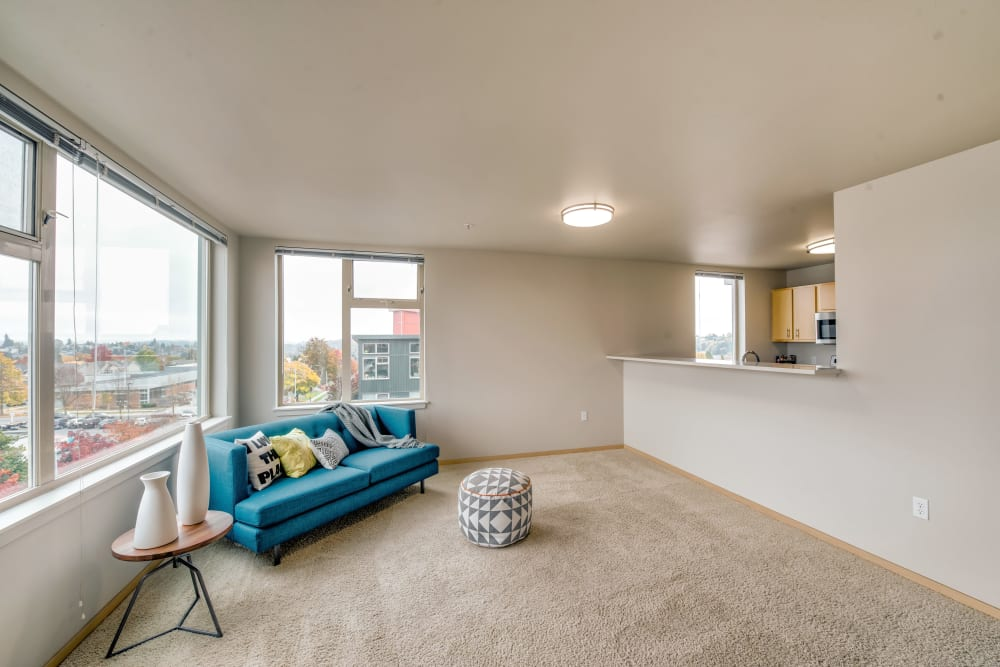 Large bay windows with an amazing neighborhood view from the living area of a model home at Verse Seattle in Seattle, Washington