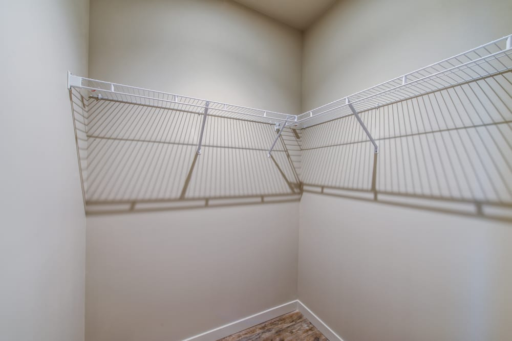 Space-saving racks in a model home's closet at Verse Seattle in Seattle, Washington