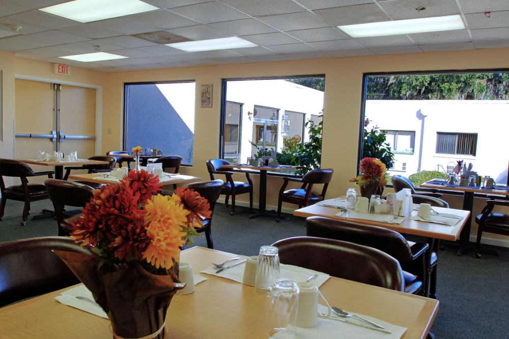 A large dining space with windows to let in natural light at Bradenton Oaks in Bradenton, Florida