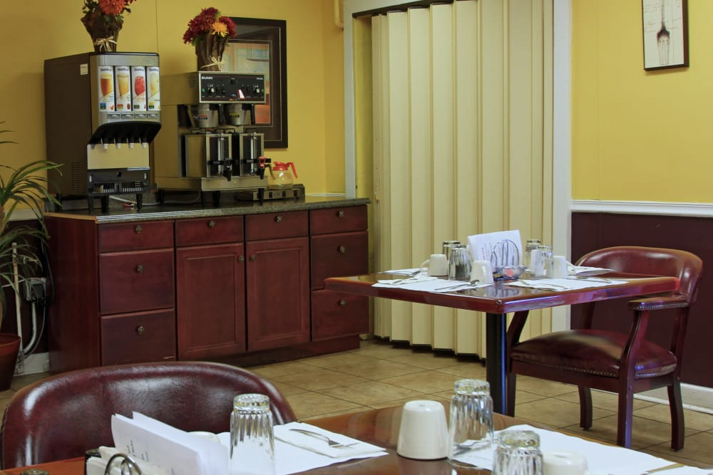 Enjoy a cup of coffee in the breakfast dining area at Bradenton Oaks in Bradenton, Florida
