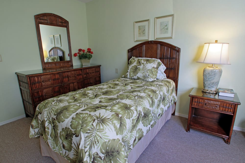 A bedroom with tropical themed decor at Bradenton Oaks in Bradenton, Florida
