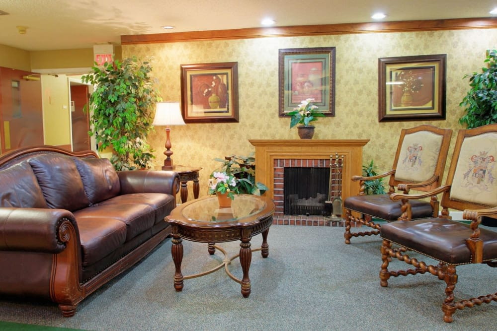 A lovely seating area complete with a fireplace at Forest Oaks of Spring Hill in Spring Hill, Florida