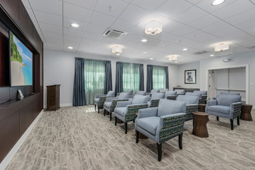 Watch a movie in the viewing room at Atrium at Liberty Park in Cape Coral, Florida
