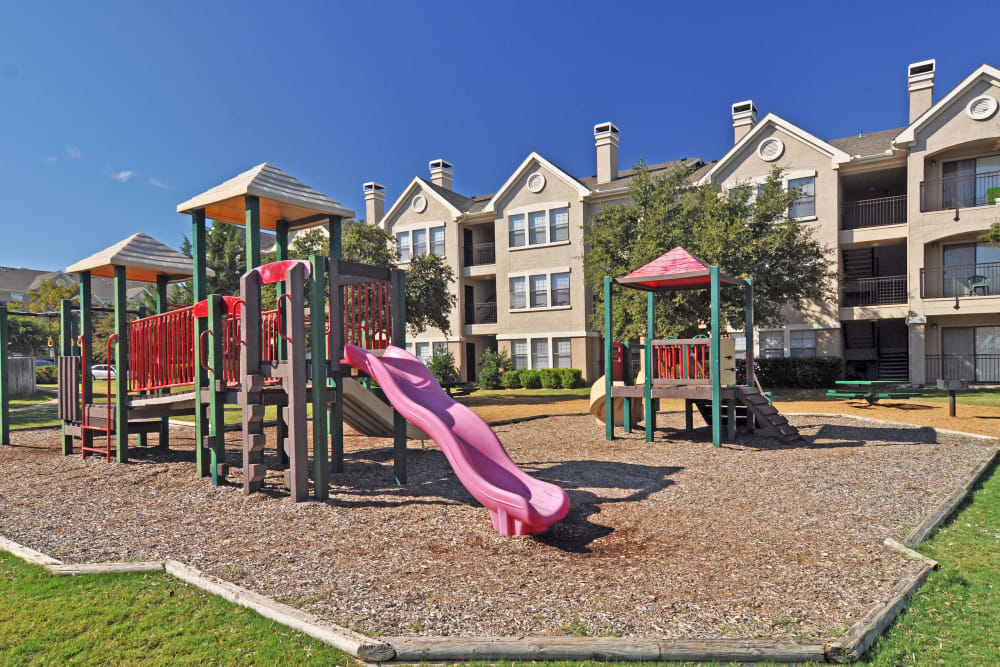 Children's playground at Arbrook Park Apartment Homes in Arlington, Texas