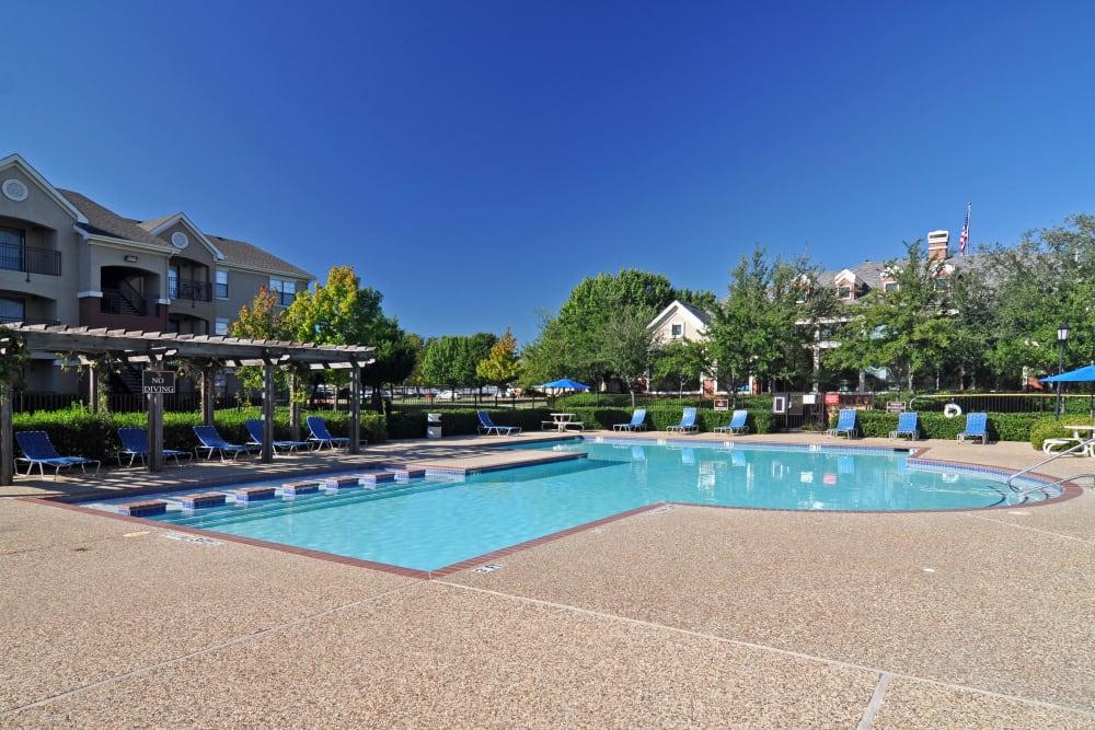 Resort-style swimming pool at Arbrook Park Apartment Homes in Arlington, Texas