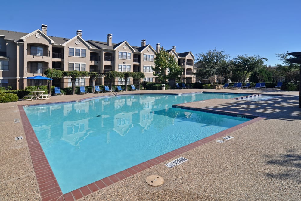 Sparkling swimming pool on a gorgeous day at Arbrook Park Apartment Homes in Arlington, Texas