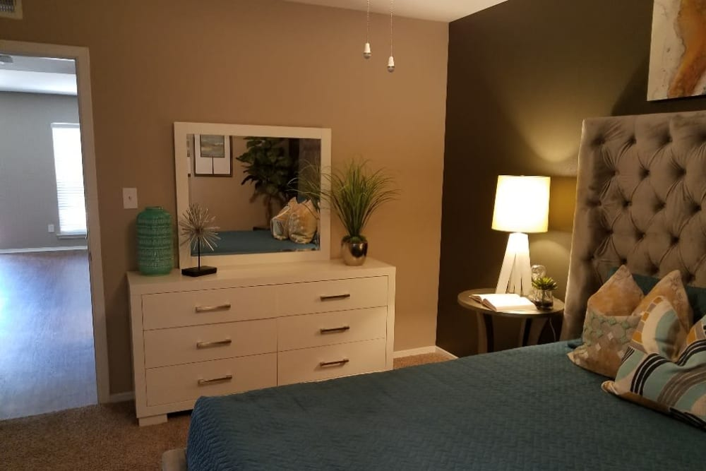 Spacious bedroom with carpet at The Villages at Meyerland in Houston, Texas