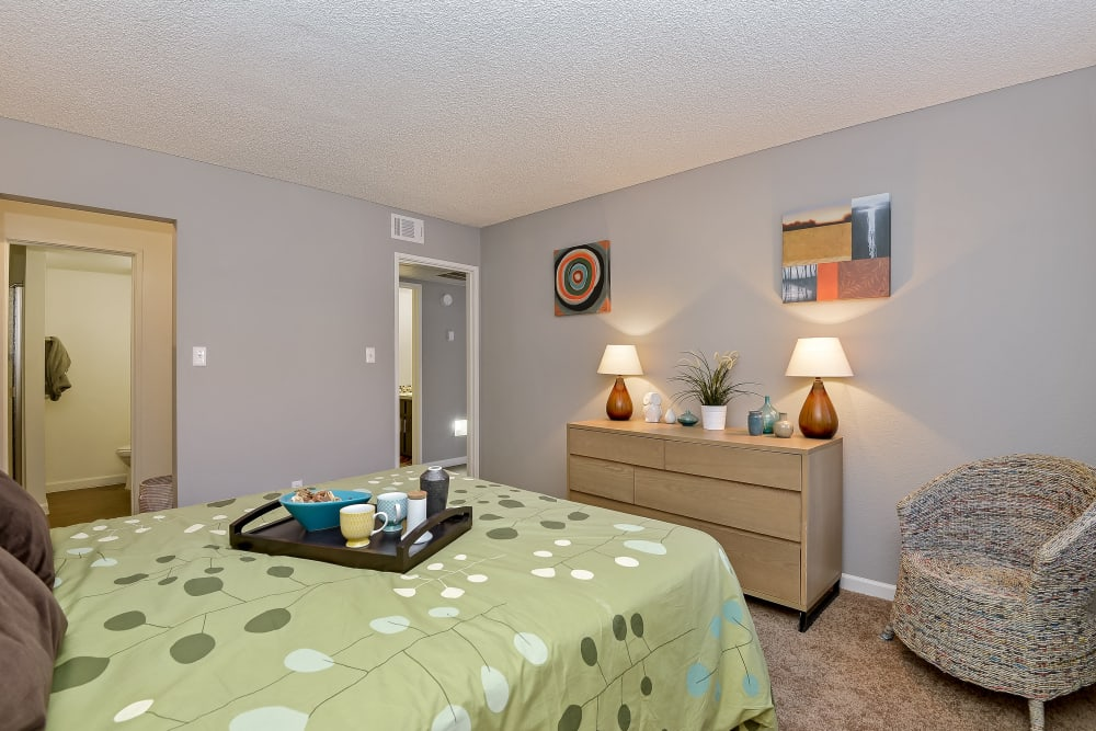 Well-decorated master bedroom with an en suite bathroom at 505 West Apartment Homes in Tempe, Arizona