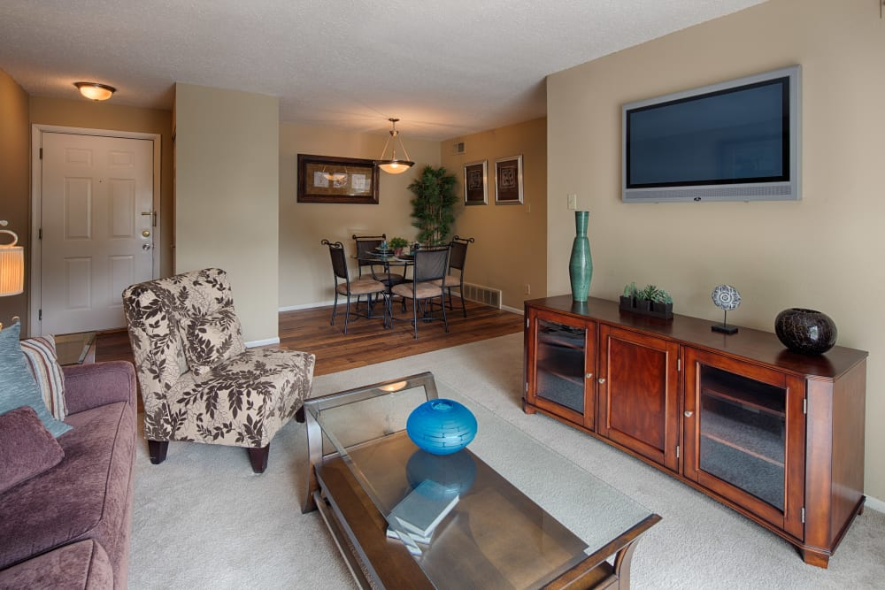 Open-concept layout with plush carpeting and an accent wall in the living area of a model home at Oxford Hills in St. Louis, Missouri