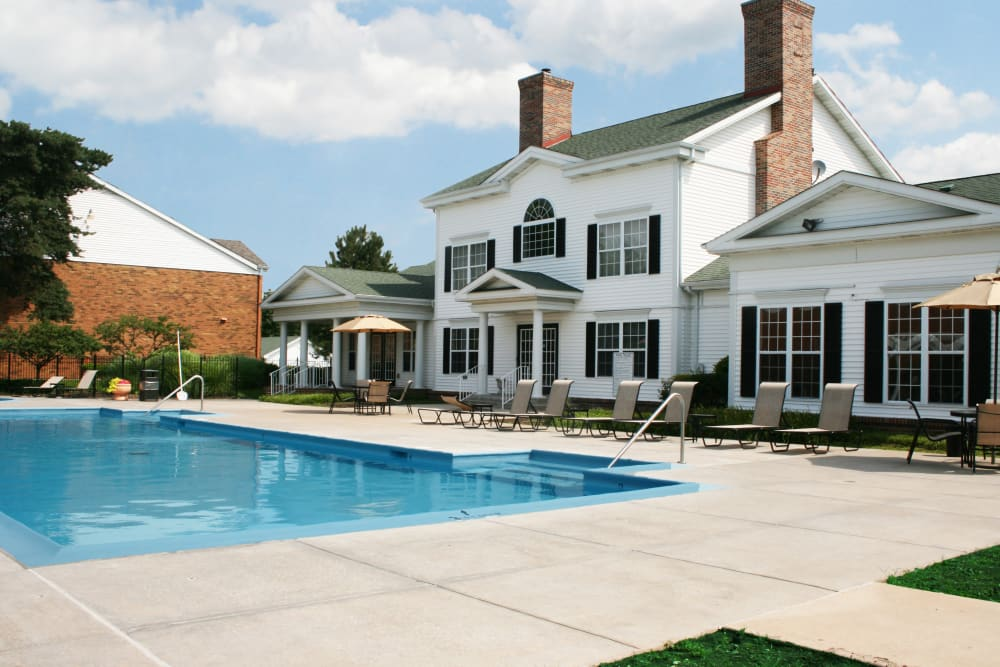 Beautiful swimming pool with expansive sun deck at Oxford Hills in St. Louis, Missouri