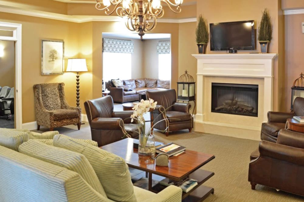 Fireplace and lounge seating in the clubhouse at Azalea Springs in Marietta, Georgia