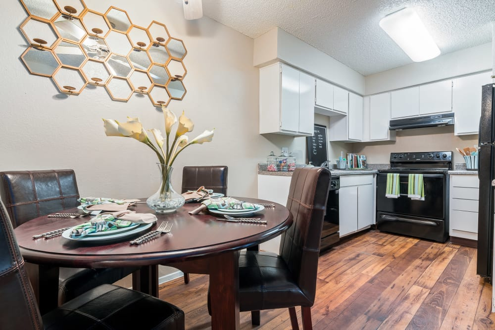 Kitchen with dining area at 8500 Harwood Apartment Homes in North Richland Hills, Texas