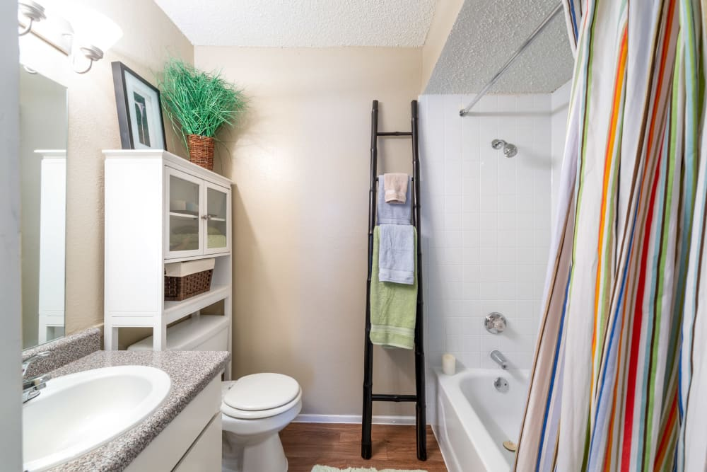 Resident bathroom with a towel rack at 8500 Harwood Apartment Homes in North Richland Hills, Texas