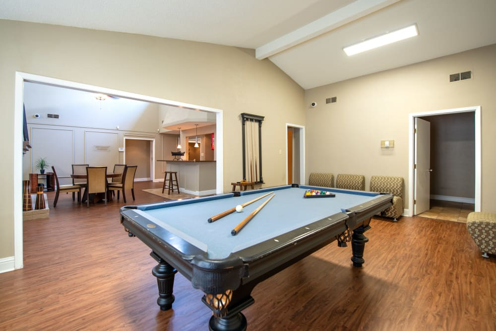 Resident clubhouse with pool table at 8500 Harwood Apartment Homes in North Richland Hills, Texas