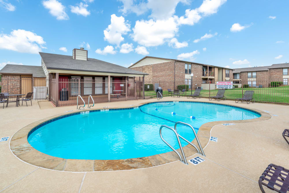 Sparkling resident swimming pool at 8500 Harwood Apartment Homes in North Richland Hills, Texas