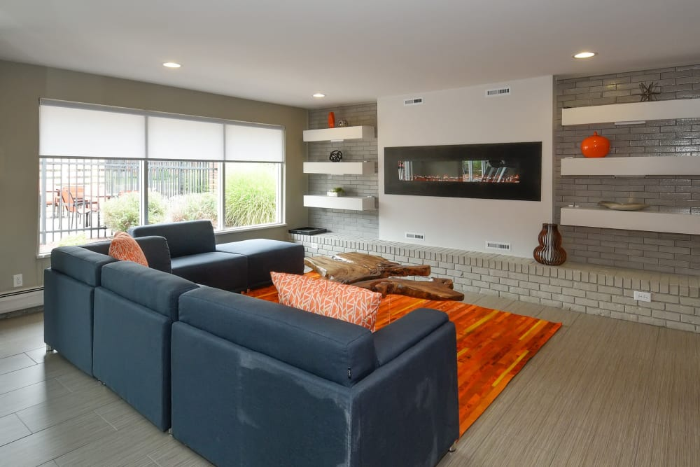 Fireplace and lounge seating in the clubhouse at Ten49 in Broomfield, Colorado