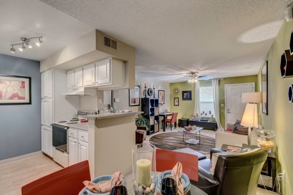 View of the kitchen and living space from the dining area of a model home at Skyline in Thornton, Colorado