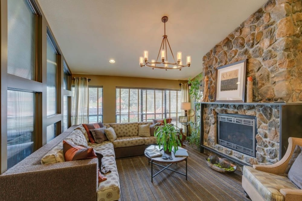 Cozy resident clubhouse with a fireplace at Skyline in Thornton, Colorado