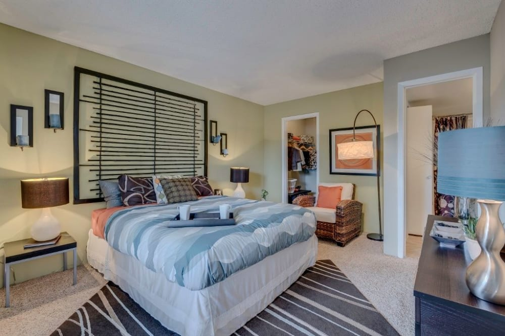 Well-furnished master bedroom in a model home at Skyline in Thornton, Colorado