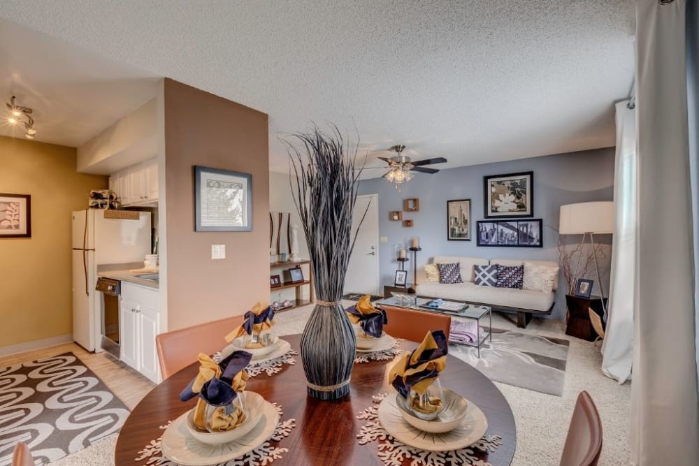 Open-concept layout with accent walls and plush carpeting in a model home at Skyline in Thornton, Colorado