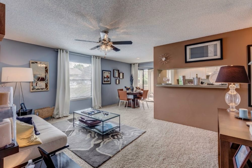 Ceiling fan and plush carpeting in a model home's living area at Skyline in Thornton, Colorado
