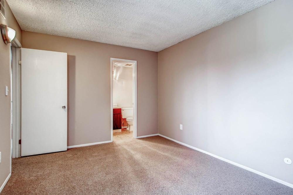 Model bedroom with private bathroom at Arvada Village Apartment Homes in Arvada, Colorado