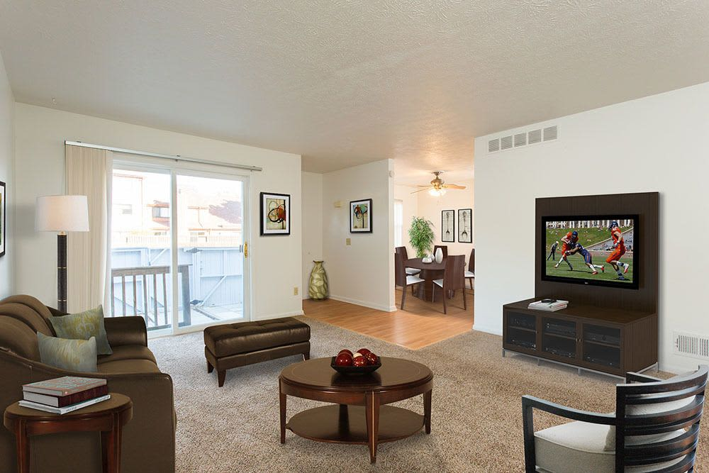 Warm living room at Brighton Colony Townhomes in Rochester, New York