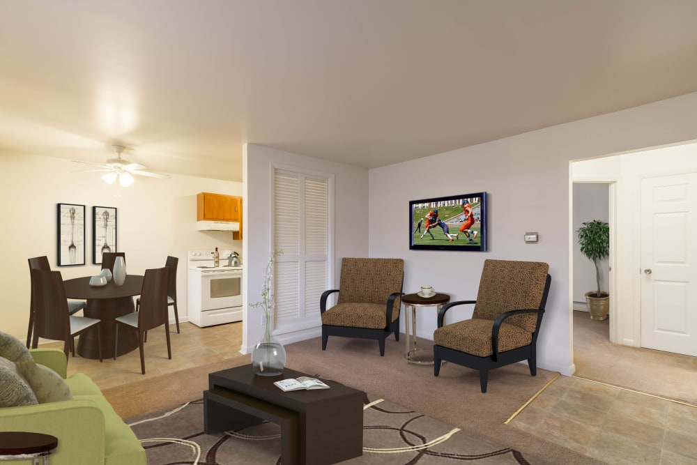 Bright living room at Penfield Village Apartments in Penfield, New York