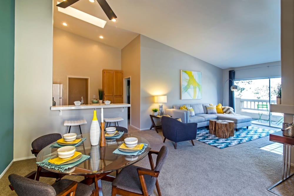 View of the living area from the dining nook of a model home at Sofi Canyon Hills in San Diego, California