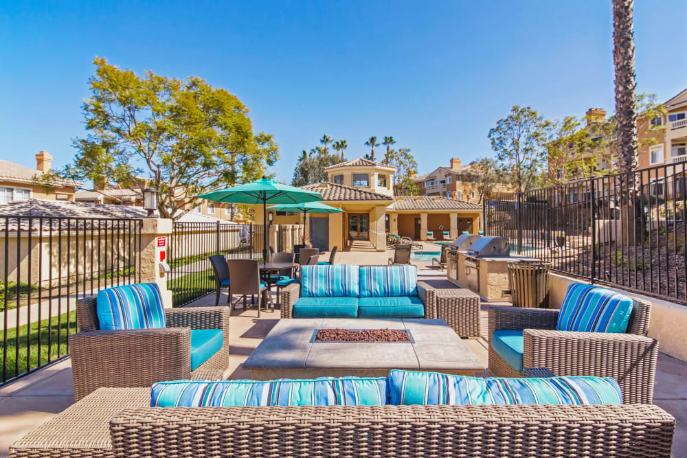 Well-furnished outdoor lounge near the fire pit at Sofi Canyon Hills in San Diego, California