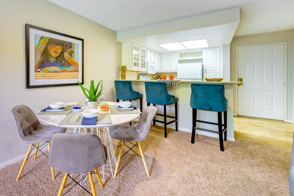 Dining area next to the kitchen's breakfast bar in a model home at Sofi Irvine in Irvine, California