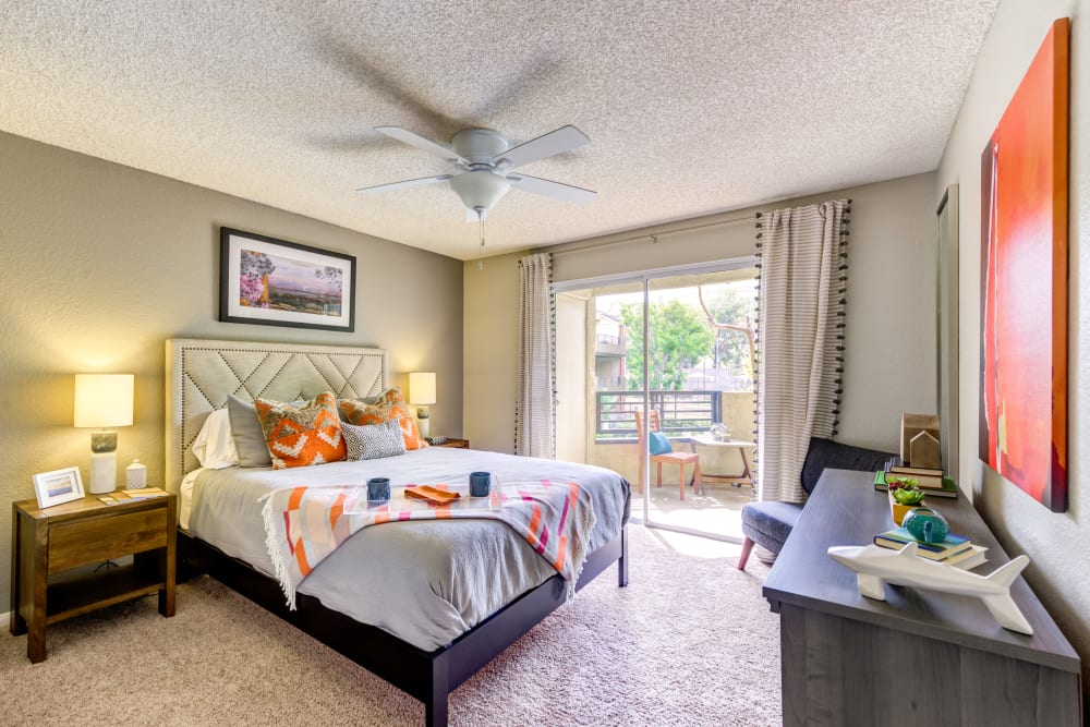 Ceiling fan and plush carpeting in a model home's master bedroom at Sofi Irvine in Irvine, California