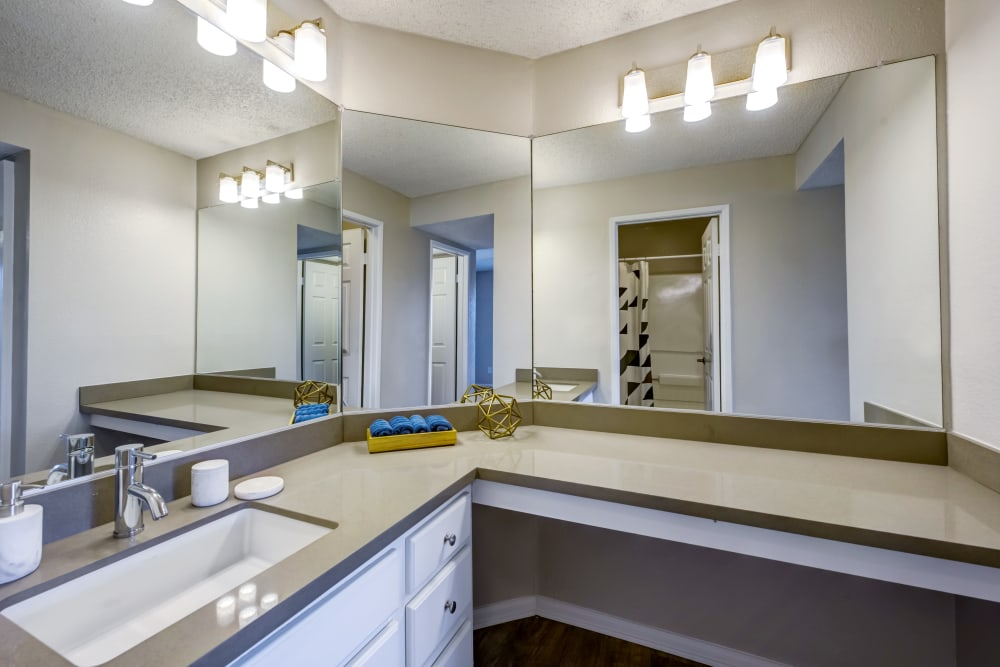 Wraparound vanity mirrors and extra countertop space in a model home's master bathroom at Sofi Irvine in Irvine, California