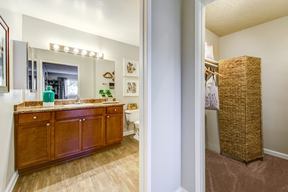 Large en suite master bathroom with an adjacent walk-in closet in a model home at Sofi Poway in Poway, California