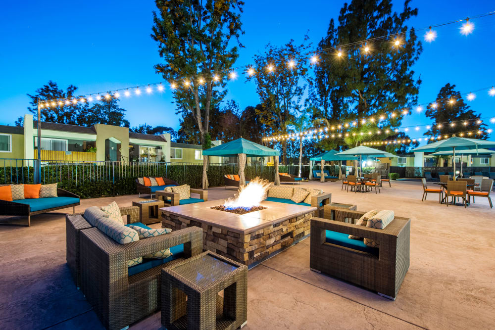 Early evening at the fire pit area surrounded by lounge seating at Sofi Poway in Poway, California