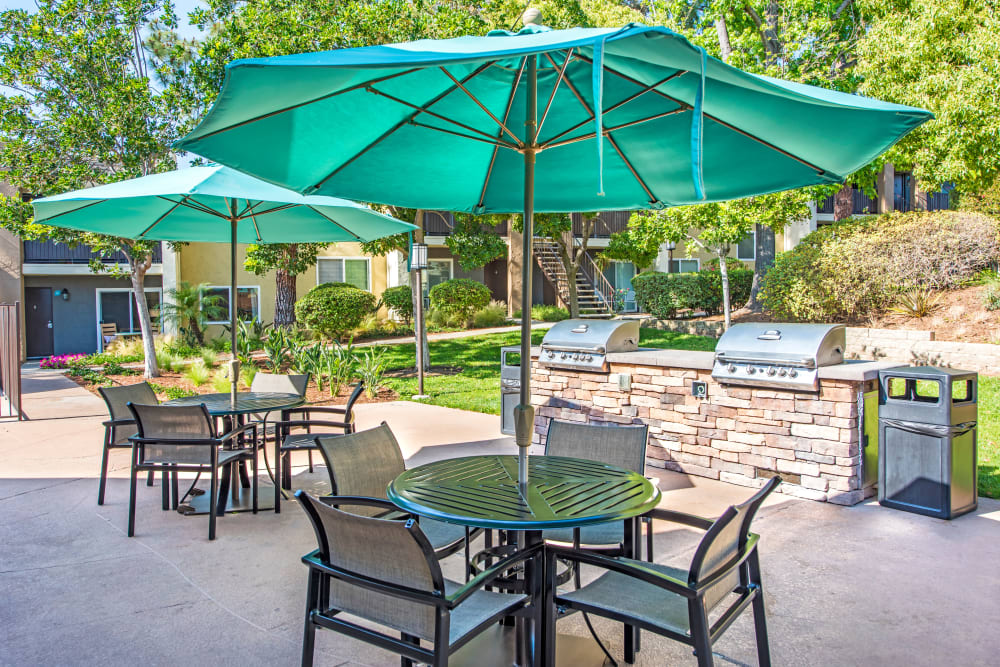 Sunny morning at the barbecue area with shaded table seating nearby at Sofi Poway in Poway, California