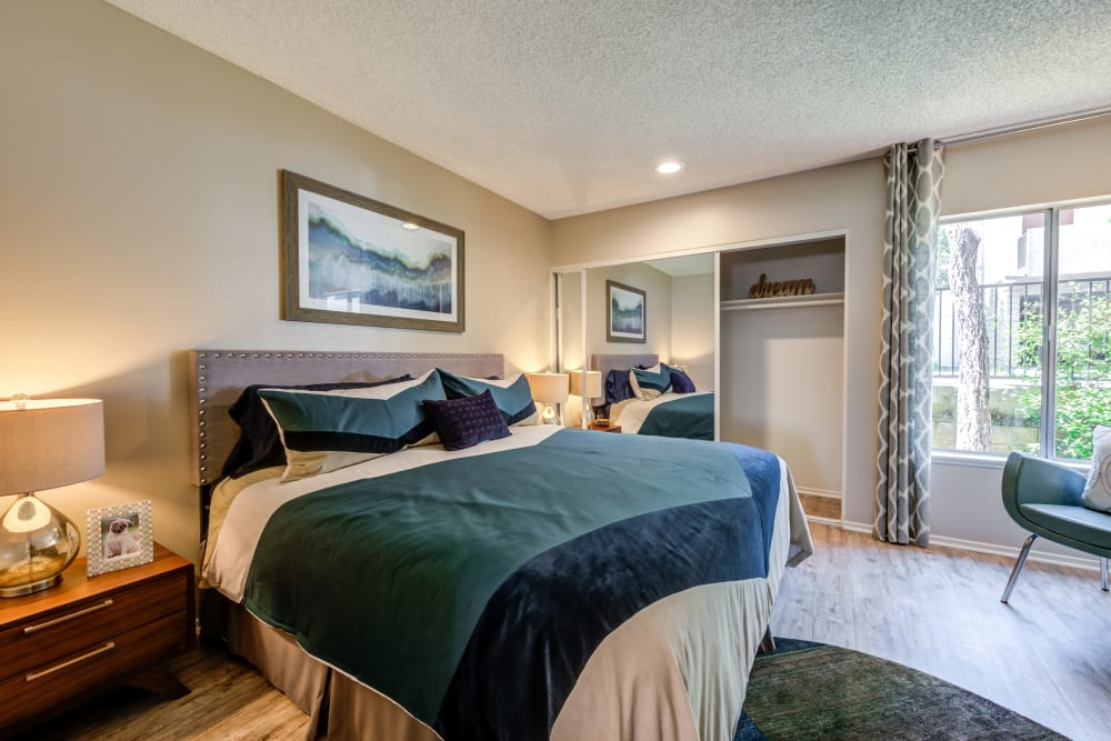 Well-furnished master bedroom with a spacious closet in a model home at Sofi Thousand Oaks in Thousand Oaks, California