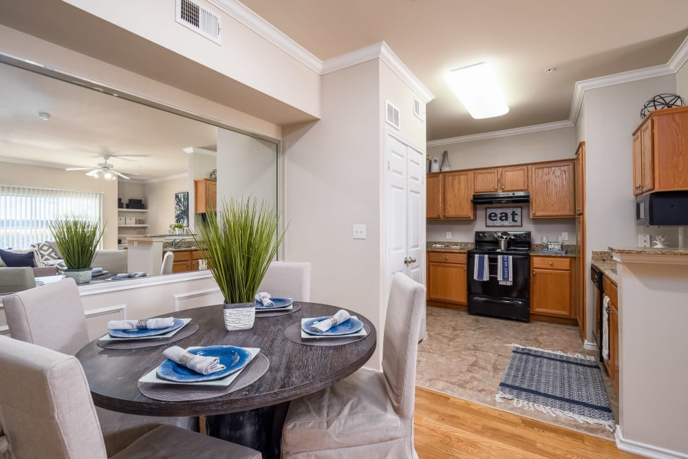 View of the modern and spacious kitchen from the dining area of a model home at Vail Quarters in Dallas, Texas