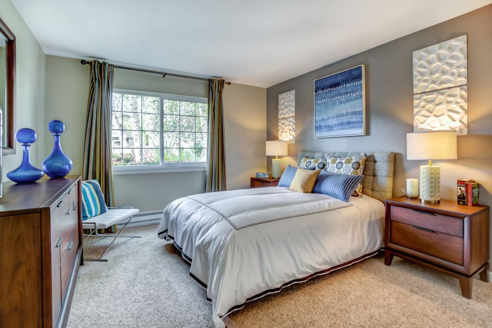 Nicely furnished master bedroom in a model home at Sofi at Los Gatos Creek in San Jose, California