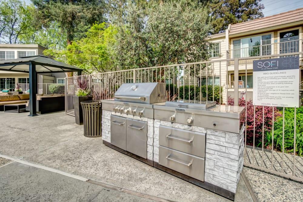 Barbecue area with gas grills at Sofi at Los Gatos Creek in San Jose, California