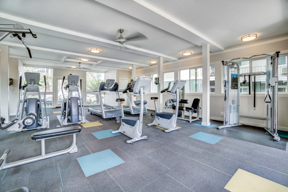 Cardio machines and weight training equipment in the fitness center at Sofi at Los Gatos Creek in San Jose, California