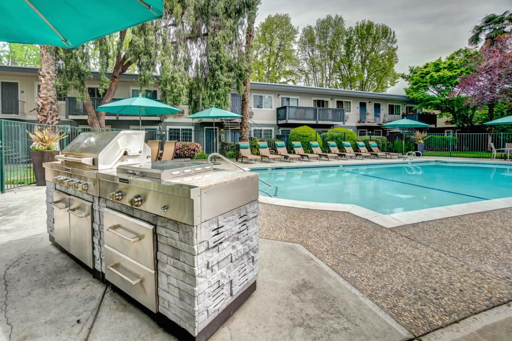 Barbecue grills near the swimming pool at Sofi at Los Gatos Creek in San Jose, California