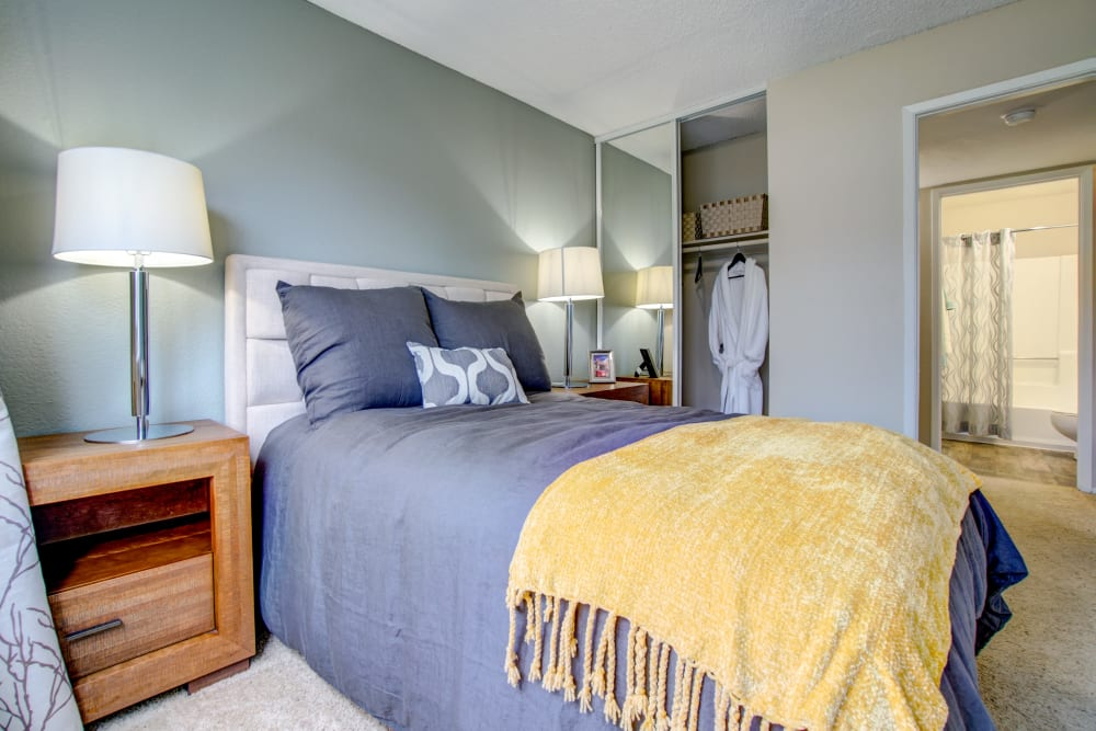 Master bedroom with an en suite bathroom in a model home at Vue Fremont in Fremont, California
