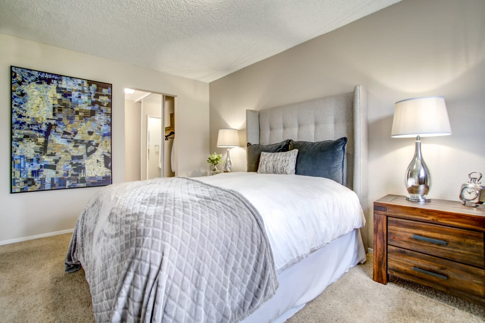 Plush carpeting in the well-furnished bedroom of a model home at Vue Fremont in Fremont, California