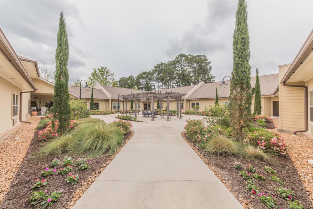 A walkway at Cedar Crest Memory Care in Lafayette, Louisiana