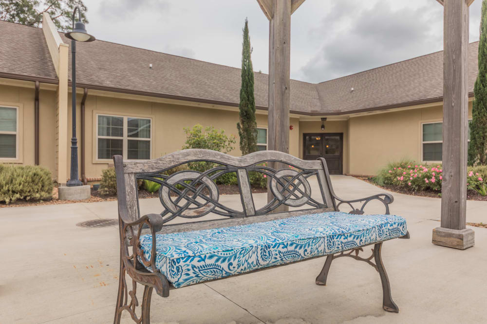 A bench outside at Cedar Crest Memory Care in Lafayette, Louisiana