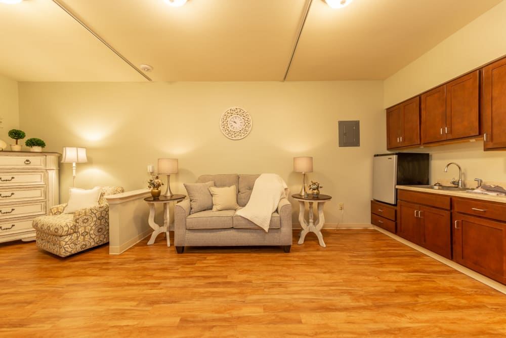 Living room and kitchenette at Cedar Crest Memory Care in Lafayette, Louisiana