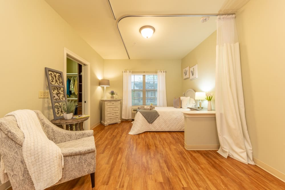 A large bedroom space at Cedar Crest Memory Care in Lafayette, Louisiana